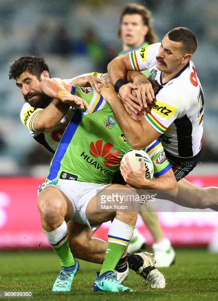Regan CampbellGillard of the Panthers tackles Liam Knight of the Raiders high during the round 14 NRL match between the Canberra Raiders and the...
