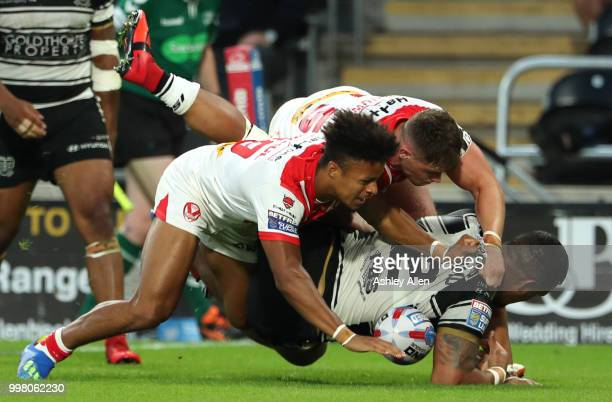 Regan Grace and Morgan Knowles of St Helens tackle Bureta Faraimo of Hull FC during the BetFred Super League match between Hull FC and St Helens...
