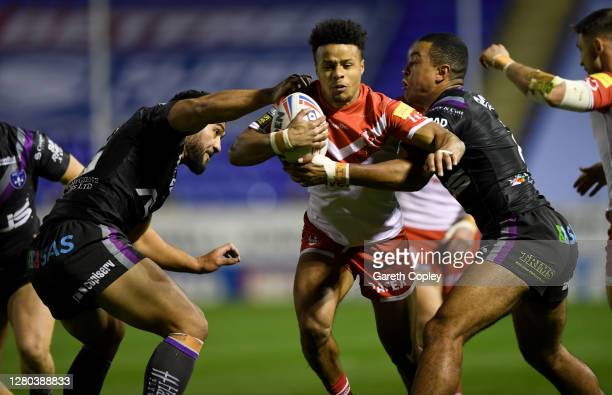 Regan Grace of St Helens is tackled by Kelpepi Tanginoa and Reece Lyne of Wakefield during the Betfred Super League match between St Helens and...