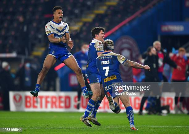 Regan Grace of St Helens leaps in the air to celebrate his side's victory during the Betfred Super League Grand Final between Wigan Warriors and St...