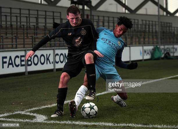 Regan Hendry of Celtic Under 19s holds of Demeaco Duhaney Manchester City Uner 19s during U19 UEFA Youth League match between Manchester City Under...