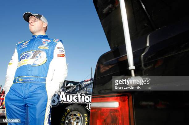 Regan Smith driver of the BTS Tire Wheel/Advance Auto Parts Ford stands by his car during practice for the NASCAR Camping World Truck Series JAG...