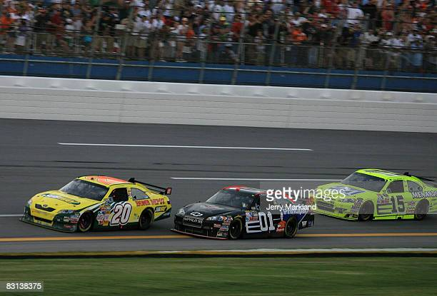 Regan Smith driver of the DEI/The Principal Financial Group Chevrolet races Tony Stewart driver of the Subway/Home Depot Toyota and Paul Menard...
