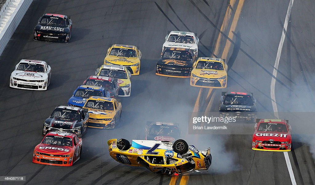 Regan Smith, driver of the #7 Hellmann's Chevrolet, flips over during an on-track incident during the NASCAR XFINITY Series Alert Today Florida 300 at Daytona International Speedway on February 21, 2015 in Daytona Beach, Florida.