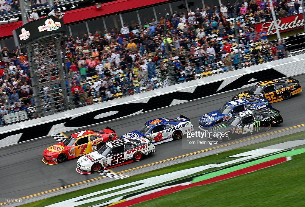 Regan Smith, driver of the #7 Ragu Chevrolet, crosses the finish line ahead of Brad Keselowski, driver of the #22 Discount Tire Ford, to win the NASCAR Nationwide Series DRIVE4COPD 300 at Daytona International Speedway on February 22, 2014 in Daytona Beach, Florida.