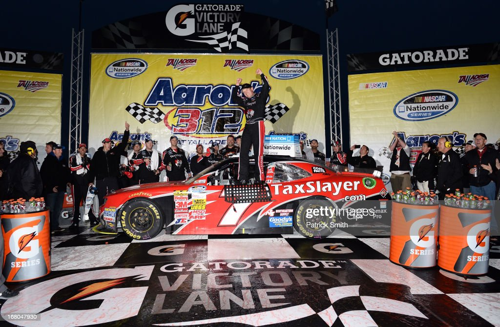 Regan Smith, driver of the #7 TaxSlayer.com Chevrolet, celebrates with his crew in victory lane after he won the NASCAR Nationwide Series Aaron's 312 at Talladega Superspeedway on May 4, 2013 in Talladega, Alabama.