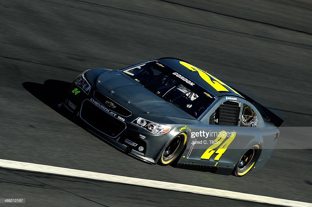 Regan Smith drives the #24 Hendrick Motorsports Chevrolet during testing at Charlotte Motor Speedway on December 11, 2013 in Charlotte, North Carolina.