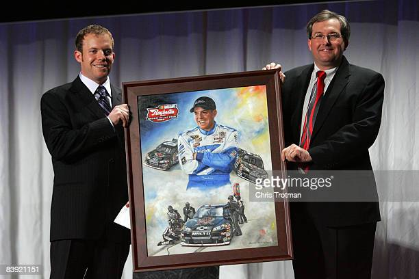 Regan Smith is presented with the Raybestos Rookie of the Year award during NASCAR Champions Week NMPA Myers Brothers Media Luncheon at Cipriani on...
