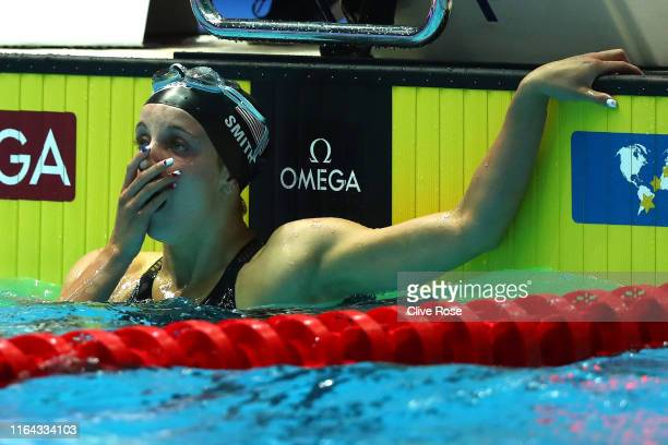Regan Smith of the United States celebrates as she sets a new world record of 20335 after competing in the Women's 200m Backstroke Semifinal on day...