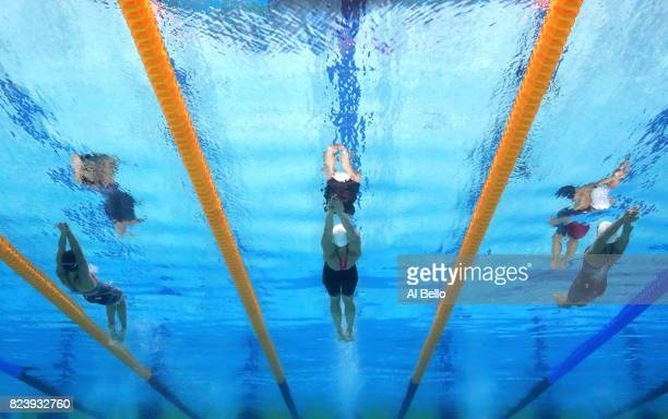 Regan Smith of the United States Katinka Hosszu of Hungary and Hilary Caldwell of Canada compete during the Women's 200m Backstroke semi final on day...