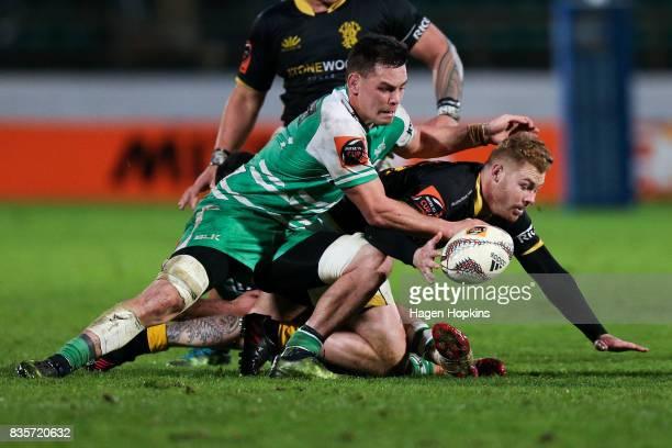 Regan Verney of Wellington is tackled by Antonio Kiri Kiri of Manawatu during the round one Mitre 10 Cup match between Manawatu and Wellington at...