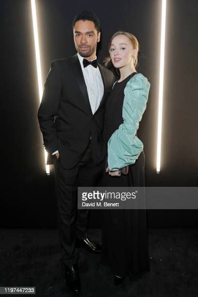 Rege-Jean Page and Phoebe Dynevor attend the dunhill & Dylan Jones Pre-BAFTA party at dunhill Bourdon House on January 29, 2020 in London, United...