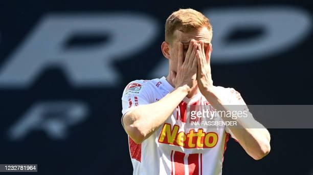 Regensburg's German-Canadian defender Scott Kennedy reacts after Regensburg scored the 2-1 own goal during the German second division Bundesliga...