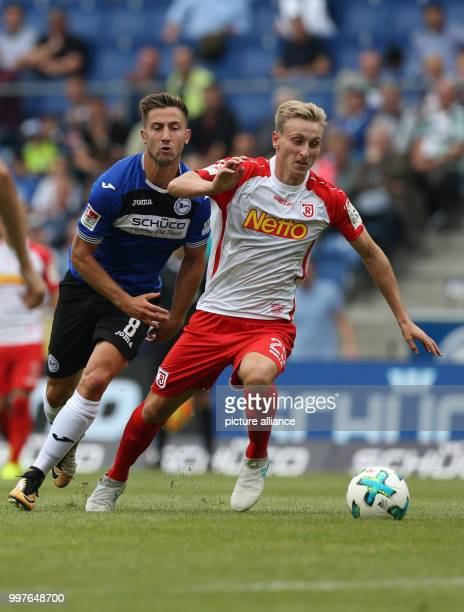 Regensburg's Sargis Adamyan and Bielefeld's Andraz Sporar vie for the ball during the German 2 Bundesliga soccer match between Arminia Bielefeld and...