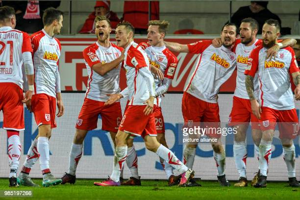 Regensburg's team celebrates the 32 goal during the German 2nd division Bundesliga soccer match between Jahn Regensburg and FC Ingolstadt 04 in the...