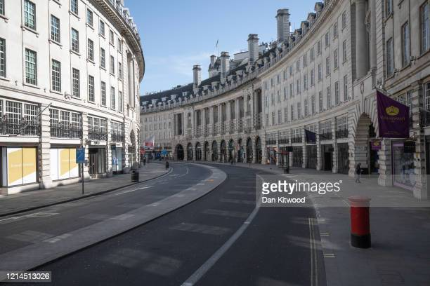 Regent Street stands empty with shops closed on March 24 2020 in London England British Prime Minister Boris Johnson announced strict lockdown...