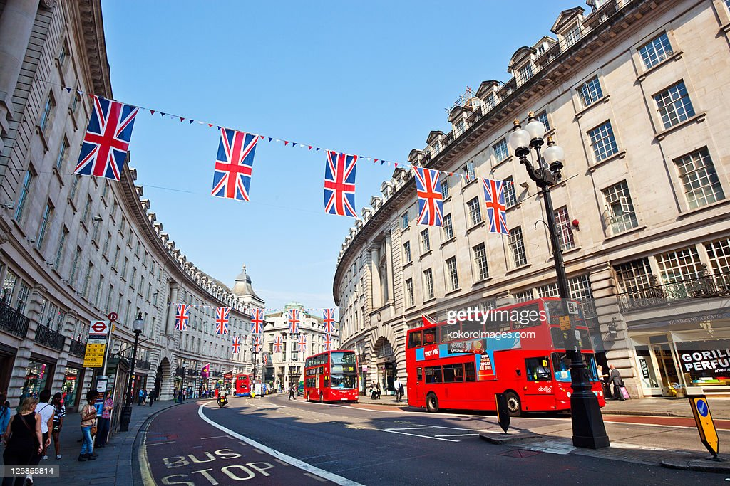 Regents St with red buses and bunting : Stock Photo