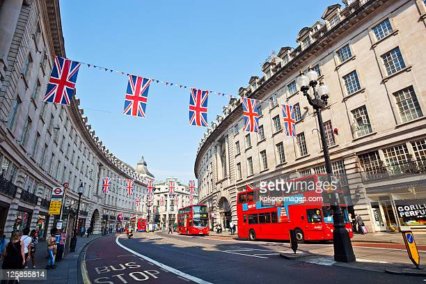 regents st with red buses and bunting - double decker bus stock pictures, royalty-free photos & images