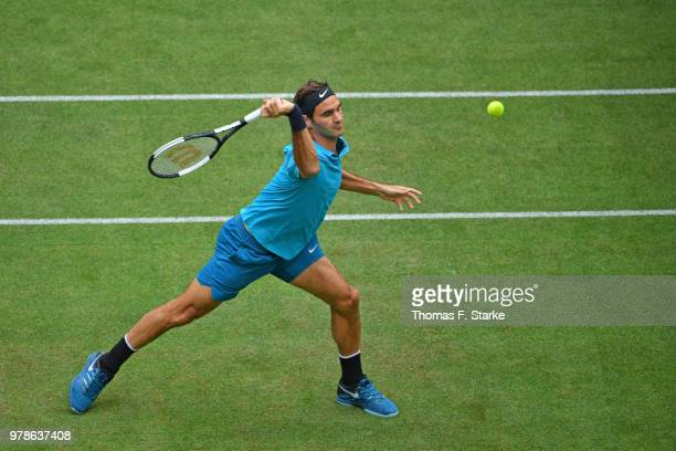 Reger Federer of Switzerland plays a forehand in his match against Aljaz Bedene of Slovenia during day two of the Gerry Weber Open at Gerry Weber...