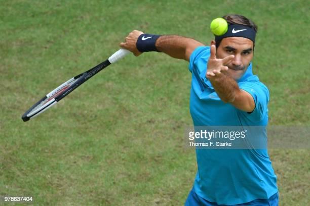 Reger Federer of Switzerland serves in his match against Aljaz Bedene of Slovenia during day two of the Gerry Weber Open at Gerry Weber Stadium on...