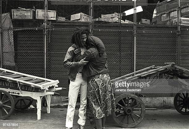 Reggae musician Cedric Myton hugs his wife Yvonne Myton in1980 in London England