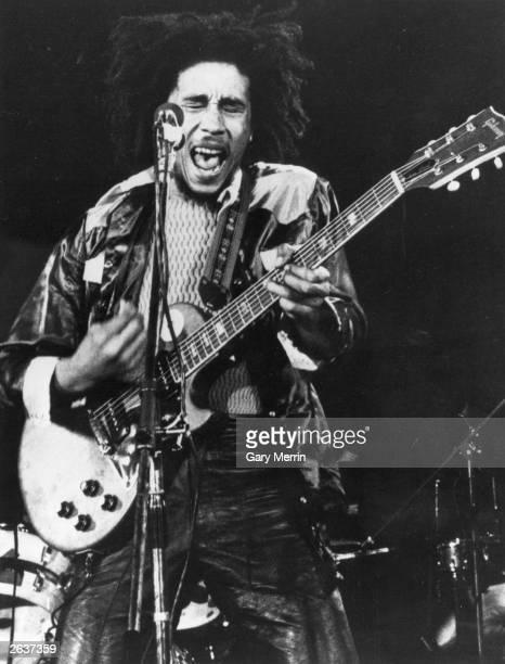 Reggae singer-songwriter Bob Marley , in concert.