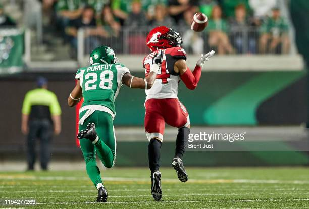 Reggie Begelton of the Calgary Stampeders hauls in a long pass for a touchdown against Loucheiz Purifoy of the Saskatchewan Roughriders in the game...
