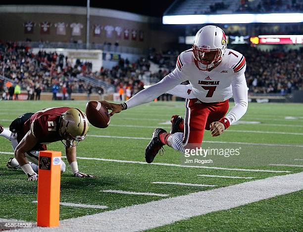 Reggie Bonnafon of the Louisville Cardinals comes up short as Justin Simmons of the Boston College Eagles defends in the second quarter at Alumni...