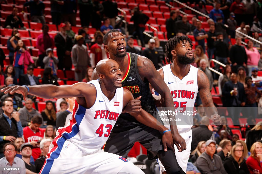 Reggie Bullock #25 and Anthony Tolliver #43 of the Detroit Pistons, react to a play with Dewayne Dedmon #14 of the Atlanta Hawks on November 10, 2017 at Little Caesars Arena in Detroit, Michigan.