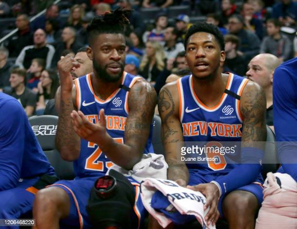 Reggie Bullock and Elfrid Payton of the New York Knicks talk on the bench during a game against the Detroit Pistons during the first half at Little...