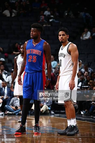 Reggie Bullock of the Detroit Pistons and Jorge Gutierrez of the Brooklyn Nets looks on during the game on October 6 2016 at Barclays Center in the...