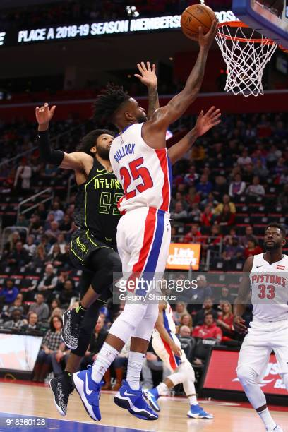 Reggie Bullock of the Detroit Pistons gets to the basket past DeAndre' Bembry of the Atlanta Hawks during the first half at Little Caesars Arena on...