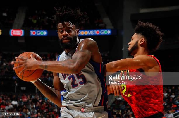 Reggie Bullock of the Detroit Pistons grabs a rebound against Tyler Dorsey of the Atlanta Hawks at Philips Arena on February 11 2018 in Atlanta...