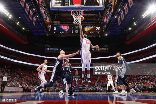 Reggie Bullock of the Detroit Pistons handles the ball against the Denver Nuggets on December 12 2017 at Little Caesars Arena in Detroit Michigan...