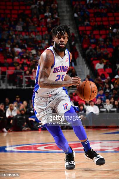Reggie Bullock of the Detroit Pistons handles the ball against the Houston Rockets on January 6 2018 at Little Caesars Arena in Detroit Michigan NOTE...