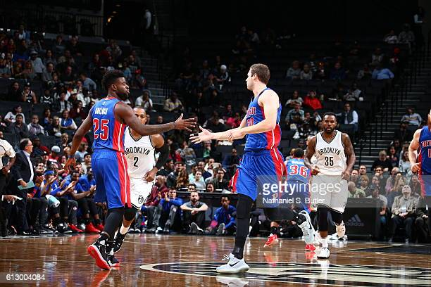 Reggie Bullock of the Detroit Pistons high fives Jon Leuer of the Detroit Pistons during the game against the Brooklyn Nets on October 6 2016 at...
