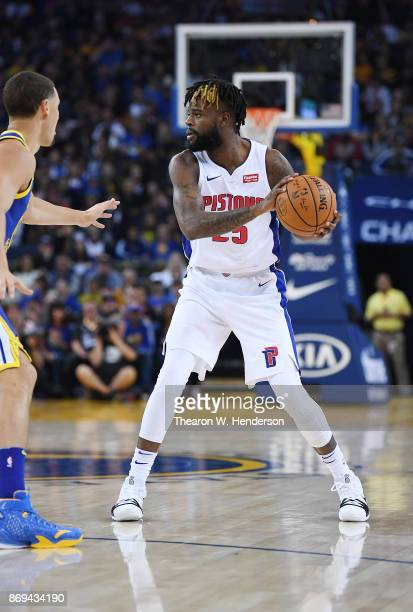 Reggie Bullock of the Detroit Pistons looks to pass the ball against the Golden State Warriors during an NBA basketball game at ORACLE Arena on...