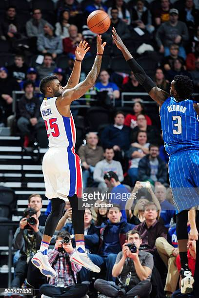 Reggie Bullock of the Detroit Pistons shoots against Dewayne Dedmon of the Orlando Magic during the game on January 4 2016 at The Palace of Auburns...