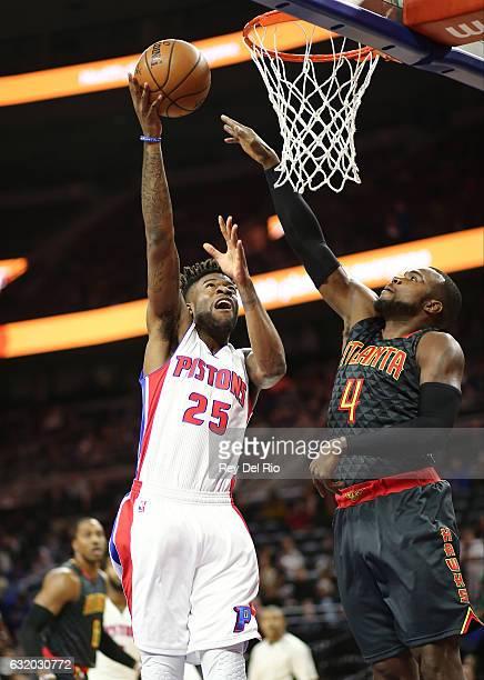 Reggie Bullock of the Detroit Pistons shoots over Paul Millsap of the Atlanta Hawks at the Palace of Auburn Hills on January 18 2017 in Auburn Hills...