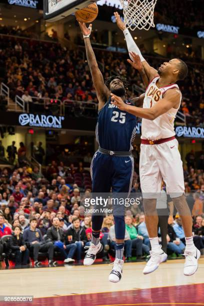 Reggie Bullock of the Detroit Pistons shoots over Rodney Hood of the Cleveland Cavaliers during the first half at Quicken Loans Arena on March 5 2018...