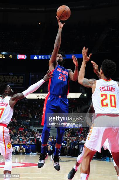 Reggie Bullock of the Detroit Pistons shoots the ball against the Atlanta Hawks on December 14 2017 at Philips Arena in Atlanta Georgia NOTE TO USER...