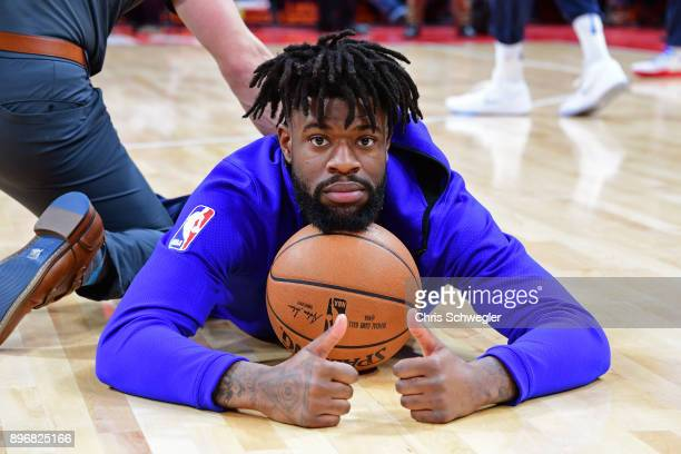Reggie Bullock of the Detroit Pistons stretches before the game against the Orlando Magic on December 17 2017 at Little Caesars Arena in Detroit...