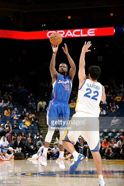 Reggie Bullock of the Los Angeles Clippers shoots against Jason Kapono of the Golden State Warriors on October 21 2014 at Oracle Arena in Oakland...