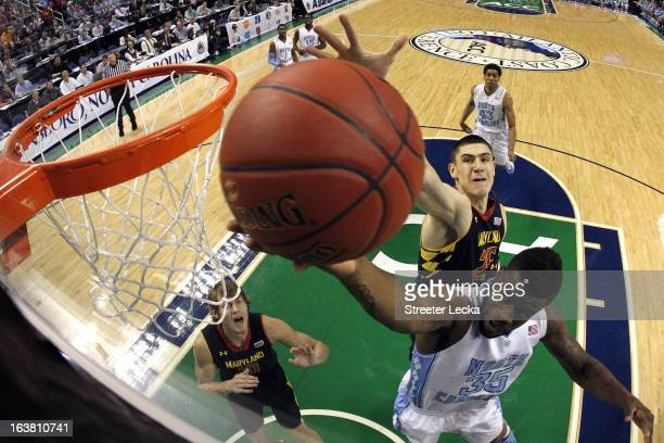 Reggie Bullock of the North Carolina Tar Heels drives to the basket against Alex Len of the Maryland Terrapins during the semifinals of the Men's ACC...