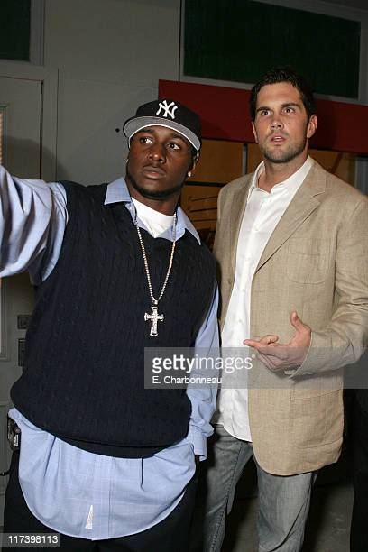 Reggie Bush and Matt Leinart during General Motors Presents 3rd Annual GM AllCar Showdown Hosted by Shaquille O'Neal Backstage and Audience at...
