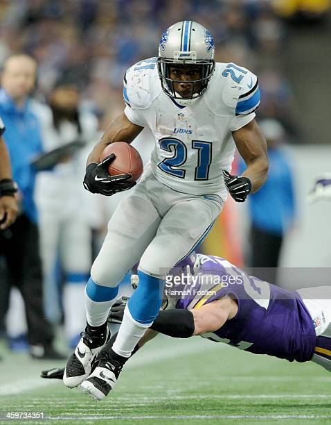 Reggie Bush of the Detroit Lions avoids a tackle by Chad Greenway of the Minnesota Vikings during the third quarter of the game on December 29 2013...