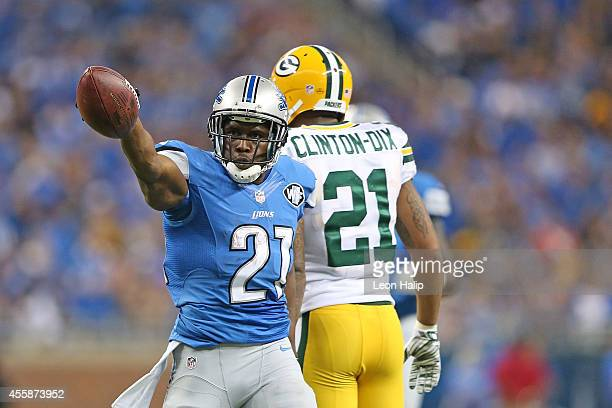 Reggie Bush of the Detroit Lions celebrates after getting a first down during the second quarter of the game against the Green Bay Packers at Ford...