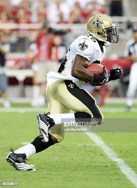 Reggie Bush of the New Orleans Saints carries the ball against the Arizona Cardinals in a preseason game at University of Phoenix Stadium August 7...