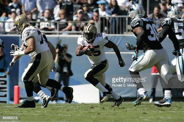 Reggie Bush of the New Orleans Saints carries the ball during a NFL football game against the Carolina Panthers at Bank of America Stadium on October...