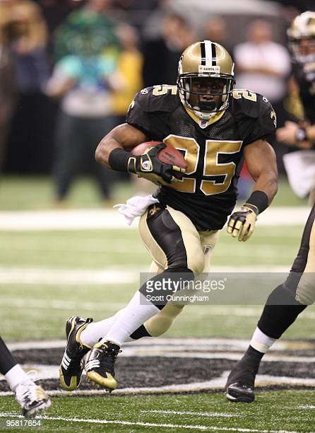 Reggie Bush of the New Orleans Saints carries the ball for a touchdown against the Arizona Cardinals in an NFC Divisional Playoff Game at the...